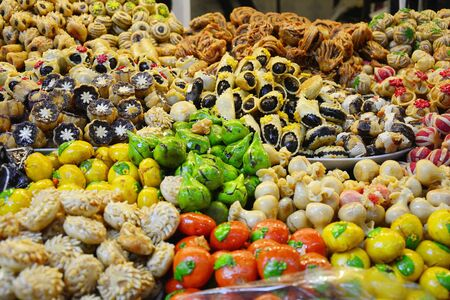 souk: Morocco, with different sweets shop in the souk of Marrakesh Stock Photo