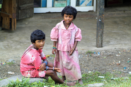 assam: Assam, India - September 30th, 2007: Unidentified female children in poorly and dirt clothes, Indian inhabitants on the border to Bhutan