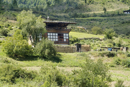 Bhutan, homestead in traditional design Stock Photo