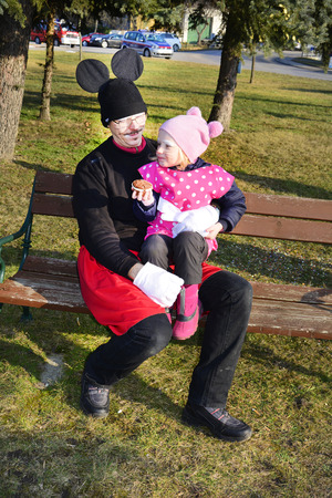 february 14th: Reisenberg, Austria - February 14th 2015: Unidentified discuisedman with child by traditional carnival revelry in the tiny village in Lower Austria