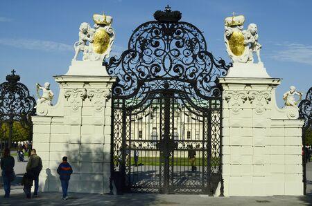 artful: Vienna, Austria - November 1st 2014: Unidentified people on artful entrance to public garden of Belvedere palace