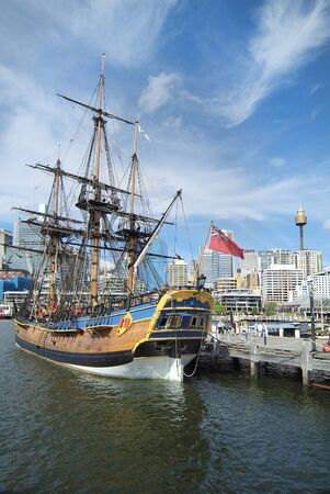 hms: Australia, HMS Endeavour replica at Maritime Museum in Darling Harbour and Sydney Tower in background Editorial