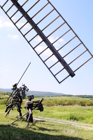 waste material: Retz, Austria - September 6th, 2005: Sculpture with legendary Don Quixote and Sancho Panza made from old iron waste material and windmill sail