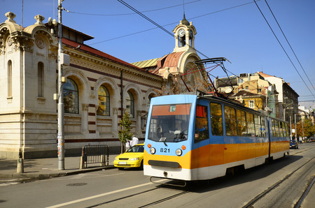 Sofia, Bulgaria - September 28th 2013: Colorful public tram on Knjginja Maria Luiza Blvd. in front of the central market hall Sofia