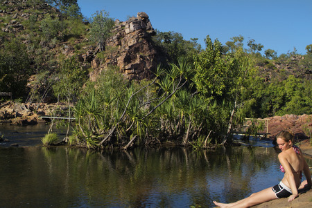edith: Katherine, Australia - April 22nd 2010: Unidentified young woman enjoy sun bathing at Edith Falls in Nitmiluk Nationalpark Editorial