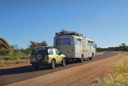 towed: Tennant Creek, Australia - April 20th 2010: Private bus with towed car for travel around the country