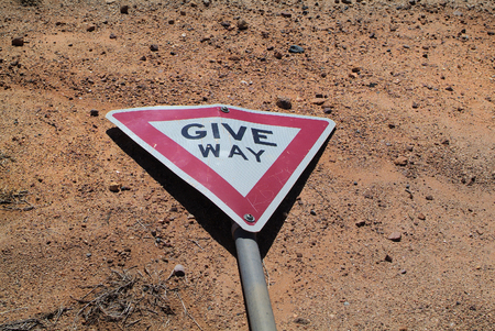 give way: Australia, give way sign - maybe too late Stock Photo