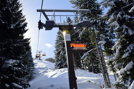 wintersport: St. Jakob, Austria - March 3rd 2015: Chairlift to mountain station on Buchensteinwand mountain, a preferred ski resort in Tyrol