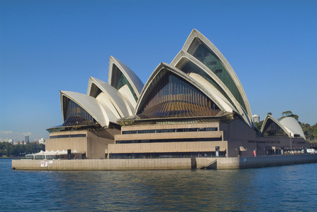 landmark: Sydney, Australia - May 7th 2010: Impressive Sydney opera house in Port Jackson, landmark and tourist attraction of the city in New South Wales