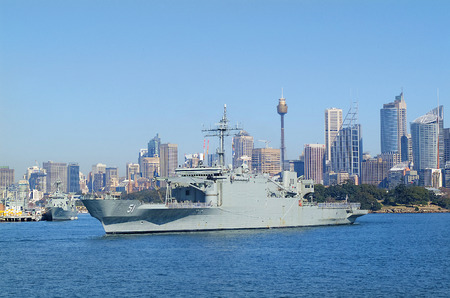port jackson: Sydney, Australia - May 10th 2010: Worship of Australian navy in Port Jackson with skyline of the city