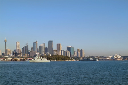 Aydney, Australia - May 10th 2010: Warship of Australian navy in front of the skyline from Sydney with Sydney tower and opera Editorial