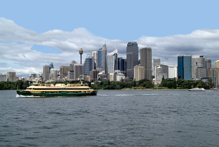 port jackson: Sydney, Australia - February 11th 2008: Usual public ferry boat in Port Jackson and skyline with Sydney tower behind