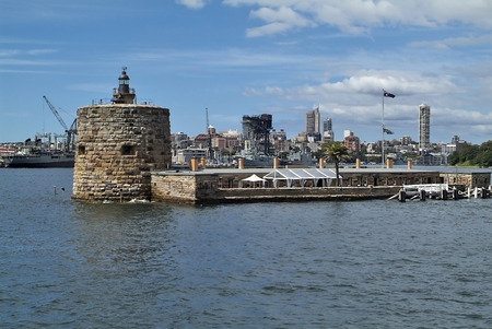 port jackson: Australia, Sydney, building Fort Denison, a former prison,  now restaurant, in background warships in Wooloomooloo wharf