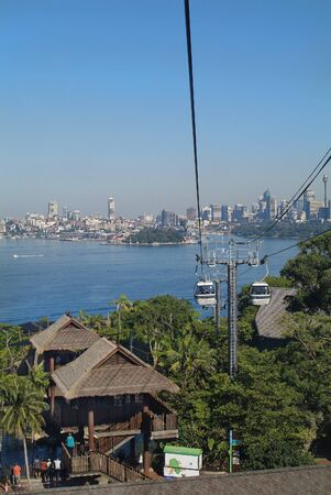 port jackson: Sydney Australia May 10th 2010: Cable car from Port Jackson to station of Taronga Zoo with skyline of Sydney Editorial