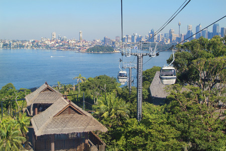 Sydney Australia May 10th 2010: Cable car from Port Jackson to station of Taronga Zoo with skyline of Sydney 報道画像
