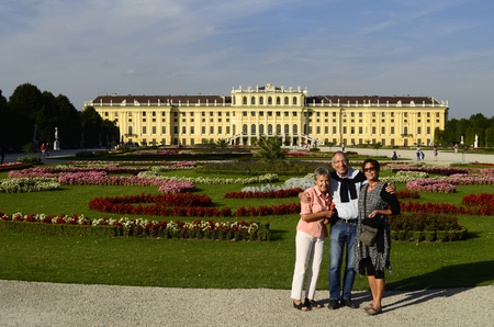 schoenbrunn: Austria, Vienna, tourists enjoy a city break in the beautiful garden of castle Schoenbrunn, the former imperial residence in the Habsburg monarchy and Unnesco World heritage site