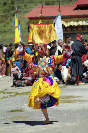 hounds: Haa, Bhutan - September 21st 2007: Masked dancer bei traditional festivity named Tshechu perform a Shawo Ahachi aka dance of stag and hounds, Editorial