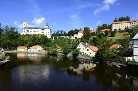 nad: Rozmberk nad Vltavou, Czechia - Ausgust 11th 2013: Castle Rozmberk and homes reflecting in river Mltava (Moldau) Editorial
