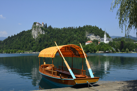 bled: Slovenia, Bled lake with castle and rowing boat named Pletna Editorial