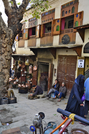 fes: Fes, Morocco - November 20th 2014: Unidentified people on place es-Seffarine in souk Fes el-Bali, place for brass article workers Editorial