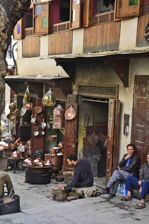 souk: Fes, Morocco - November 20th 2014: Unidentified on place es-Seffarine in souk Fes el-Bali, place for brassware workers