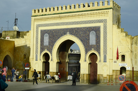 souk: Fes, Morocco - November 20th 2014: Unidentified people at Bab Boujeloud the entrance to souk Fes el-Bali Editorial
