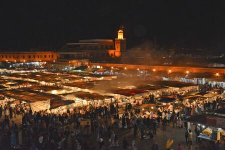 preferred: Marrakesh, Morocco - November 22nd 2014: Crowd of unidentified people on Djemaa Elfna square on evening, UNESCO World Heritage Site and preferred place for inhabitants and tourists
