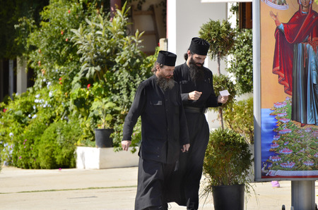 Ouranoupoli, Greece -  September 29th 2011: Unidentified monks named Pope in the border village on their way to Holy Mount Athos