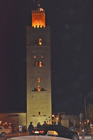 marrakesh: Marrakesh, Morocco - November 22nd 2014: Unidentified people in front of illuminated Koutoubia mosque, landmark and place of worship