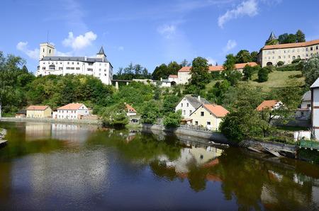 bohemia: Rozmberk nad Vltavou, Czech Republic - castle and homes reflecting in Vltava river Vltava in Bohemia