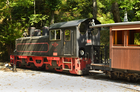 thessaly: locomotiv and cars of the nostalgic Moutzouris-Smudgy train in Milies, Greece Editorial