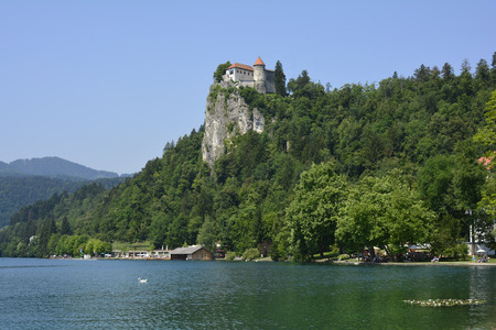 recreation area: Bled, Slovenia - July 7th 2015: Unidentified people at lake bled with castle above, preferred tourist attraction and recreation area