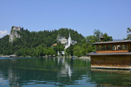 boat house: Slovenia, boat house on lake, castle and church in Bled