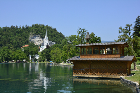 boat house: Slovenia, boat house on lake and church in Bled Stock Photo