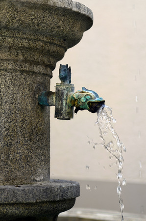 linz: Austria, Linz, detail of drinking water fountain named planet Fountain in arcade Court of cottage building