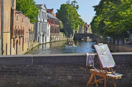 the world heritage: Belgium, Bruges, UNESCO world heritage, easel with painting from the Dijver Canal