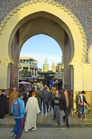 fes: Fes, Morocco - November 20th 2014: Unidentified people and Bab Boujeloud, entrance to souk fes el-Bali Editorial