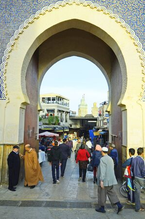 bab: Fes, Morocco - November 20th 2014: Unidentified people and Bab Boujeloud, entrance to souk fes el-Bali Editorial