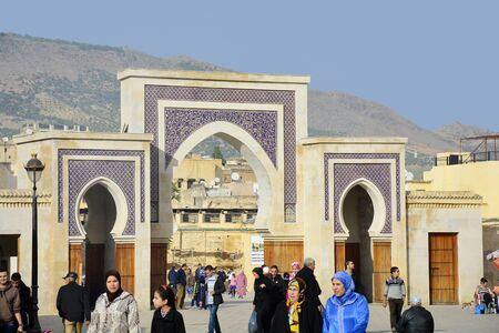bab: Fes, Morocco - November 20th 2014: Unidentified people in front of Bab Rcif entrance to Medina and souk, a unesco world heritage site Editorial