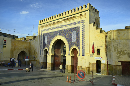 fes: Fes, Morocco - November 20th 2014: Unidentified people in front of Bab Boujeloud, entrance to Medina and souk Fes es-Bali