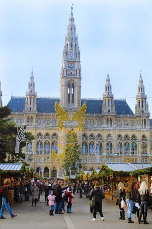 christkindlmarkt: Vienna, Austria - November 29th 2011, crowd of unidentified people on traditional christmas market named Wiener Christkindlmarkt in front of the Vienna town hall Editorial