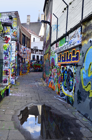permitted: Ghent, Belgium - May 31st, 2011: Graffiti in Werregarenstraat, a narrow street where it is permitted for street art paintings and a tourist attraction in this city Editorial