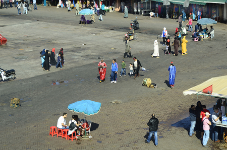 preferred: Marrakesh, Morocco - November 23rd 2014: Unidentified people on Djemaa el-Fna, Unesco world heritage site and preferred place for tourists and inhabitants,