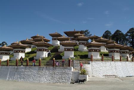 the memorial: Dochu La, Bhutan - September 23rd, 2007: Unidentified people on Druk Wangyal memorial on Dochu La Pass, it includes 108 chorten holy number in Buddhism Editorial