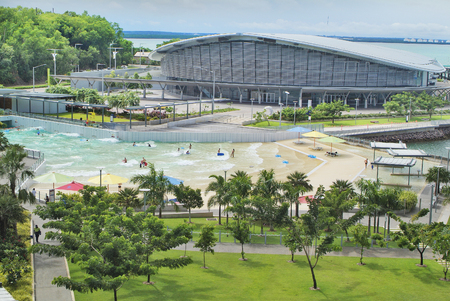 Darwin, Australia - April 28th 2010: Darwin Convention Center at Wharf Precinct - Waterfront - and unidentified people in wave pool named The Lagoon