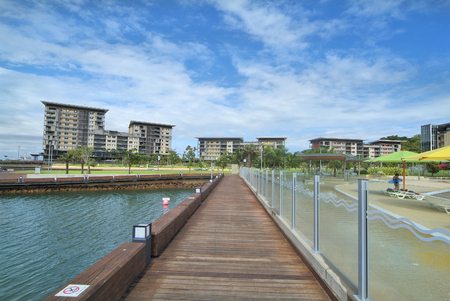 darwin: Australia, Darwin, new homes on the Wharf Precinct - Waterfront - with the wave pool named The Lagoon