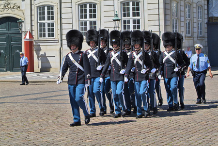royal guard: Copenhagen, Denmark - June 23rd 2009: Unidentified soldiers of the Royal Guard on parade in Amalienborg Castle Editorial