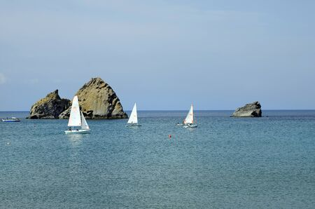 aegean: Greece, sailing boats and rocks in aegean sea Stock Photo