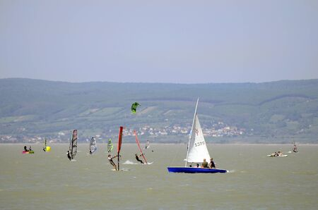 watersports: Podersdorf, Austria - April 29th 2012: Unidentified people in saling boats and wind surfer on Neusiedler lake in Burgenland Editorial