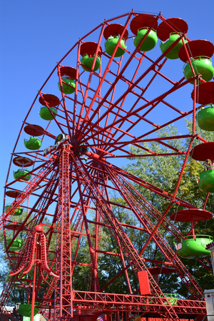 linz: Linz, Austria - October 2nd 2015: Colorful giant wheel on yearly funfair named Urfahraner Markt, market for pleasure and goods